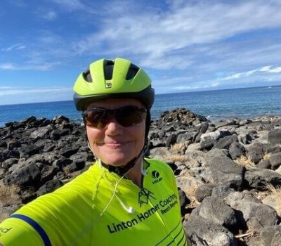 performance coach Anne Linton biking in Hawaii
